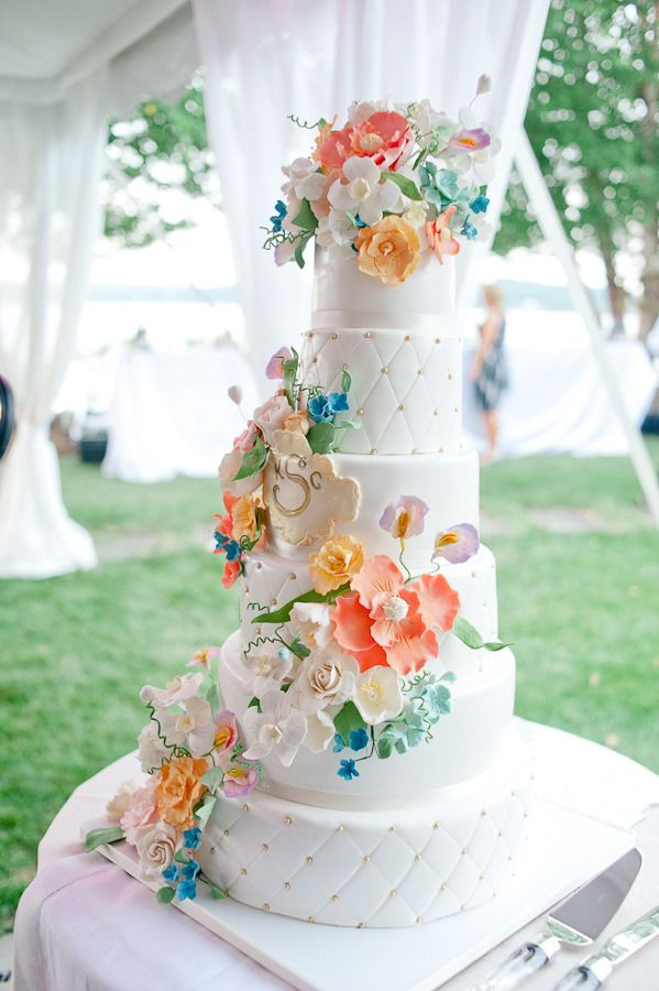 Lots & Lots of Colorful Flowers on the Wedding Cake! See more on SMP: http://www.StyleMePretty.com/2013/06/27/old-saybrook-connecticut-wedding-from-true-event-leila-brewster-photography/ Wedding Cake: A Little Imagination Cakes - imaginethatcake.com --LeilaBrewsterPhotography.com