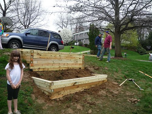Raised Bed On Hill With 4x4 Landscape Timbers For The