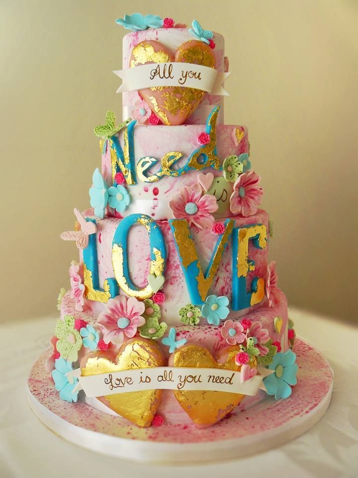 Holy cow, Beatles quote and fun colorful cake? Too bad it looks like it would be so pricey! maybe something similar with cupcakes?