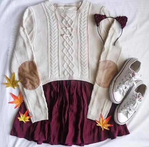 13. Cable knit sweater with a maroon skirt, white Chucks, and a cute maroon rose bud head band