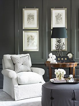 Beautiful Living Room with dark charcoal wall paneling--makes artwork white Chair pop