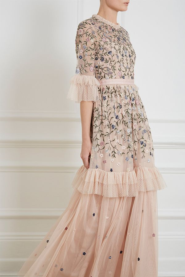 5cd75ae018f8 The Dusk Floral Gown in rose quartz is developed from a combination of  dotted and plain tulle, decorated with intricate floral embroidery.