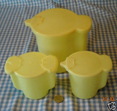 sugar cream and milk tupperware. My Grandma used to have these if I remember correctly