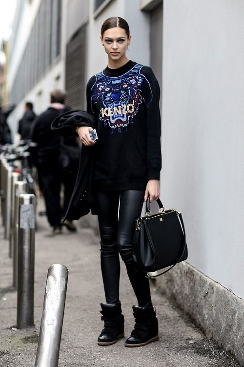 Shop model Zhenya Katava's look for $145:  http://lookastic.com/women/looks/black-oversized-sweater-and-black-leggings-and-black-handbag-and-black-wedge-sneakers/1346  — Black Print Oversized Sweater  — Black Leather Leggings  — Black Leather Handbag  — Black Leather Wedge Sneakers