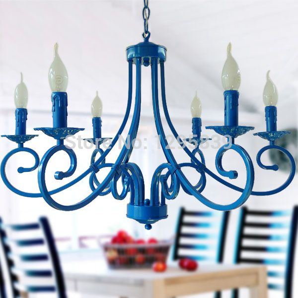 A gorgeous chandelier in blue with chic candle lights.