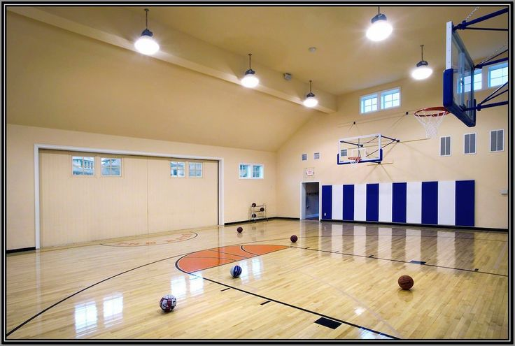 Indoor basketball court home basket ball sports image for Basketball court inside house