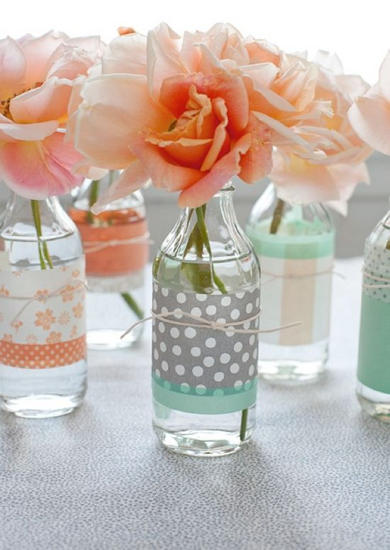i love washi tape but never know what to do with it -- love this idea of using it to turn old glass bottles into beautiful vases!