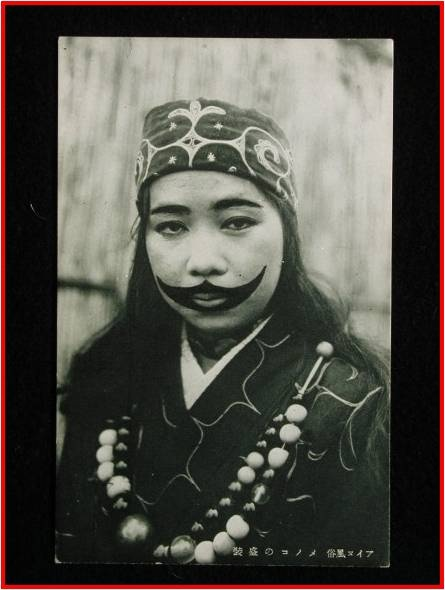 Ainu facial tatoo, magical design motifs on clothing.