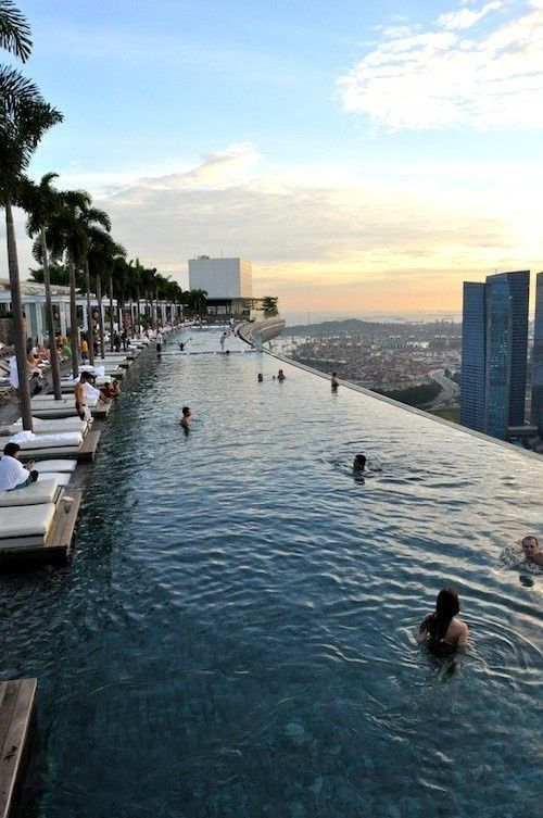 the famous infinity pool atop Marina Bay Sands. the pool is only available to hotel guests but you can pay a fee to go up and see the singapore skyline from the rooftop garden. alternatively you could grab a drink at rooftop bar ce la vi (previously 'ku de ta) and get the exact same view.