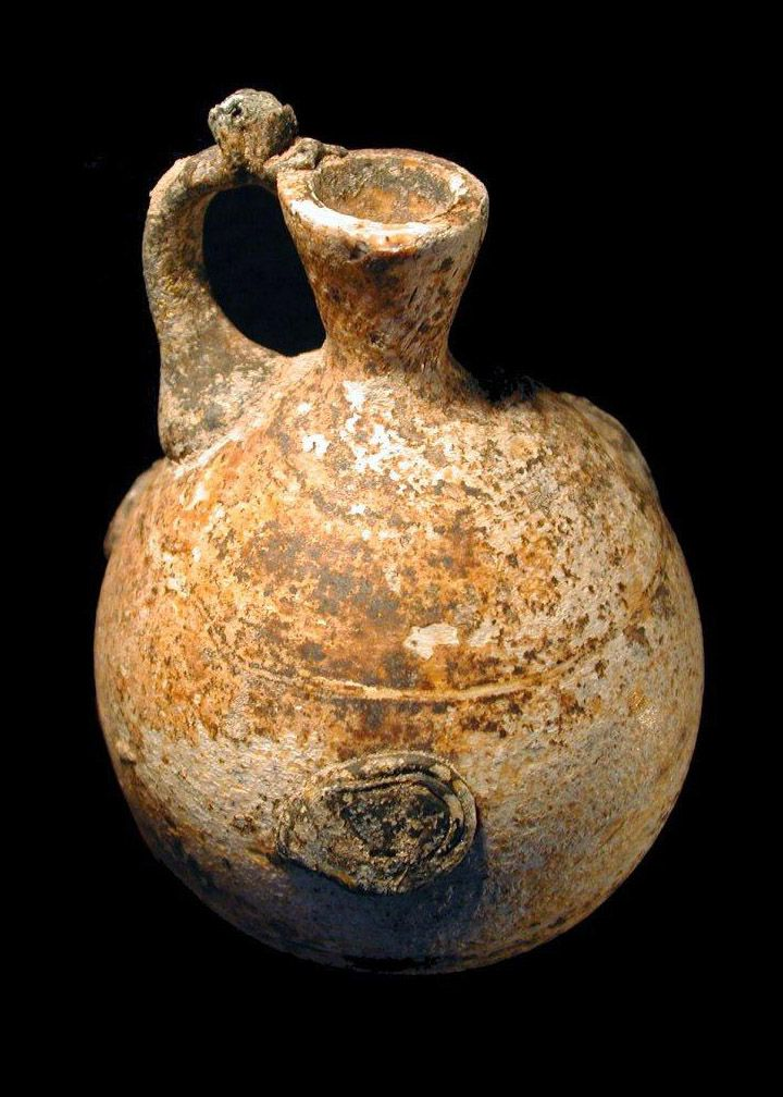 Islamic Glass Bottle. Sassanian Empire. With attached handle, feet, and ornamental disks. Glass makers inherited many of the techniques of their forebears in the Byzantine and Sasanian Empires, including glassblowing, the use of molds, the manipulation of molten glass with tools, and the decorative application of molten glass. Nice Style! See more at londoncoin.com