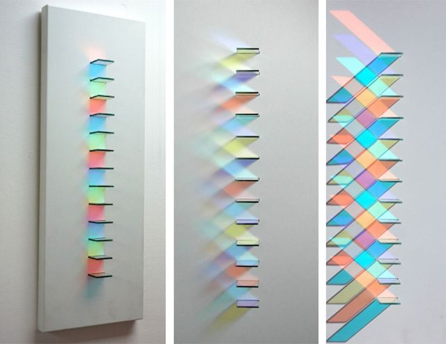 English artist Christine Wood uses little squares in glass to create very beautiful circular artworks where the light reflects different colorful patterns on the wall. She plays with geometry, shadows and the viewers' perception