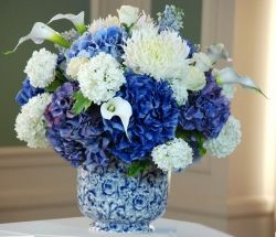 I really like how this vase adds more to this White and Blue Flower Arrangement