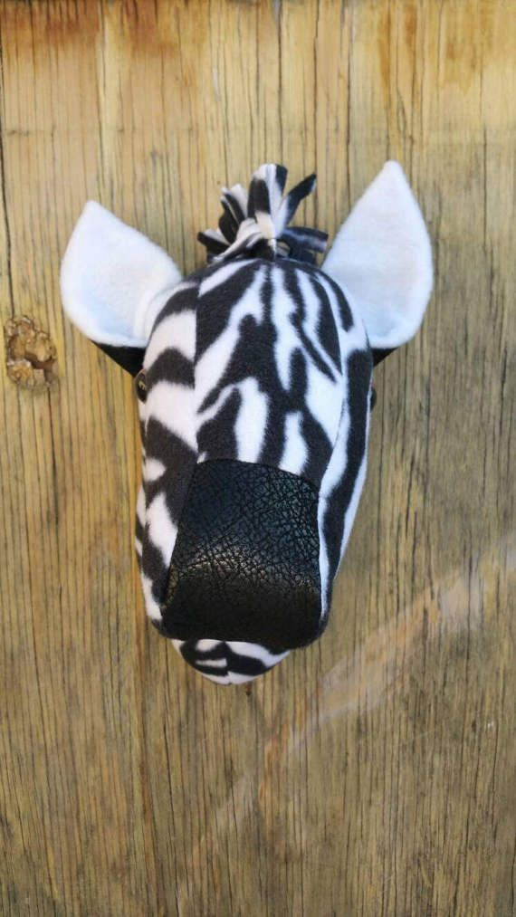 Check out this item in my Etsy shop https://www.etsy.com/listing/504803824/zebra-plush-faux-taxidery-wall-hanging