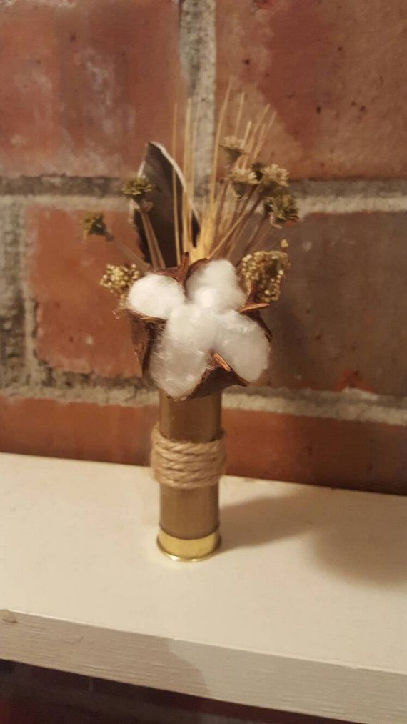 Check out this item in my Etsy shop https://www.etsy.com/listing/478045331/boutonniere-shotgun-shell-boutonniere