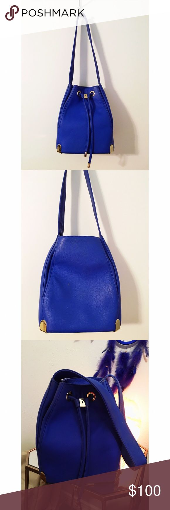 Vince Camuto leather drawstring handbag Lightly worn, great condition, genuine leather Vince Camuto drawstring handbag with gold hardware.     Style: Janet Drawstring Bag                                                   Color: Lapis Blue Vince Camuto Bags Shoulder Bags