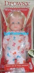 """1964-1980's Drowsy, 14"""" tall, vinyl head and hands on earliest dolls, later hands were cloth, stuffed cloth body, pull cord talker, sleep eyes, and painted facial features, earliest dolls were dressed in a Kitty print sleeper with feet and rear drop seat, later ones in same sleeper design now in pink with large white polka dots, both versions the box doubles as a cradle.    Marked on tag on back (the polka dot version, Kitty version maybe same or different): 3091 Drowsy 1964 Mattel.     ❤❦♪♫"""