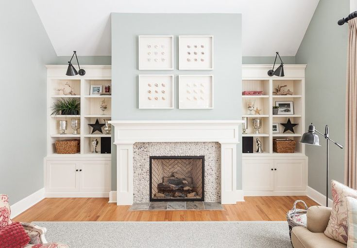 canada white fireplace mantel with southwestern wall sculptures living room transitional and beige sofa built-in bookcase