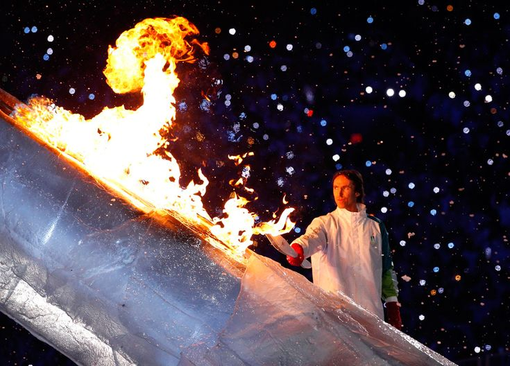 Steve Nash helps to light the Olympic flame.