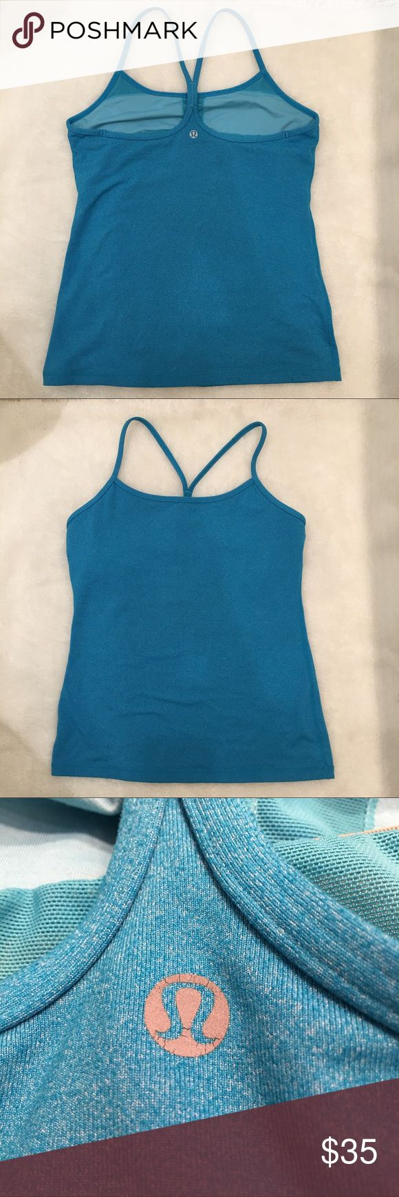 Lululemon Bright Blue Y Top size 10 Preowned authentic Lululemon Bright Blue Y Top size 10. Builtin bra, no pads. Signs of normal wear. Please look at pictures for better reference. Happy shopping! lululemon athletica Tops Tank Tops