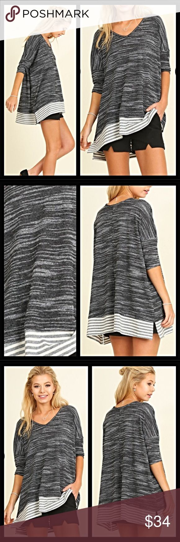 """Marled Slouchy Lightweight Sweater Tunic SML Super sassy & super relaxed/slouchy little marled lightweight sweater tunic in black & white.   Features: • Marled soft cotton blend fabric • Pullover V-neck Slouchy Style • 3/4 Sleeves  • Split hem with contrasting stripes  Small 2/4/6 Bust 48"""" Length 27"""" Medium 8/10 Bust 49"""" Length 28"""" Large 12/14 Bust 50""""'Length 29"""" Tops"""