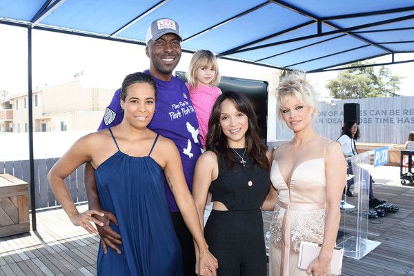 Pamela Anderson Photos - (L-R) TV personality Daphne Wayans, former NBA player John Salley, actress/dancer Mayte Garcia, and actress Pamela Anderson attend the LA launch party for Prince's PETA Song at PETA on June 7, 2016 in Los Angeles, California. - LA Launch Party for Prince's PETA Song