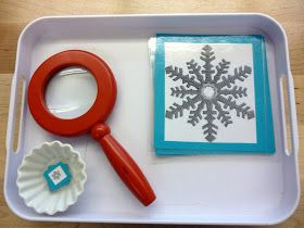 I made this work using different snowflakes (found them online: made 1 large copy and 1 tiny copy of each), construction paper, and a laminater. The children use the magnifying glass to look at the tiny snowflakes and match them with the identical large snowflake.