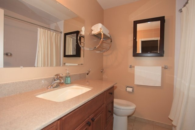 Renovated full 4 piece bath services the remaining 3 bedrooms on the upper level.