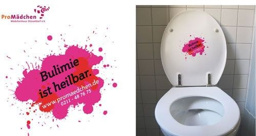 "Ok, potentially problematic, we'll grant you that. But it's got good intentions: a guerrilla campaign organized by ProMädchen and a German ad agency has created anti-bulimia stickers with the tagline ""Bulimia is curable."" The stickers (which include a hotline for help) are stuck on toilet lids in schools and colleges."