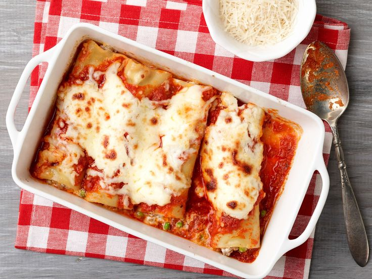 Baked Manicotti with Sausage and Peas recipe from Giada De Laurentiis via Food Network; can just put jarred pasta sauce and mozz on top and use the white stuff to fill twice the amount of manicotti and freeze one tray.KA