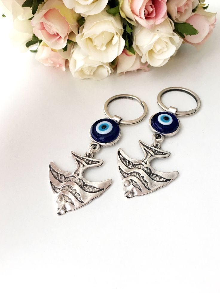A personal favourite from my Etsy shop https://www.etsy.com/listing/542900365/evil-eye-keychain-fish-keychain-evil-eye Evil eye keychain, fish keychain, evil eye fish key chain, good luck keychain, fish keyring, evil eye charm keychain, nazar boncuk
