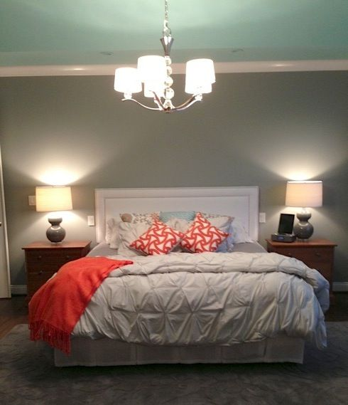 Dark coral and light teal with gray wall