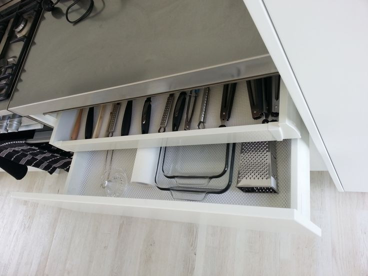 Hidden roll out drawer within larger drawer