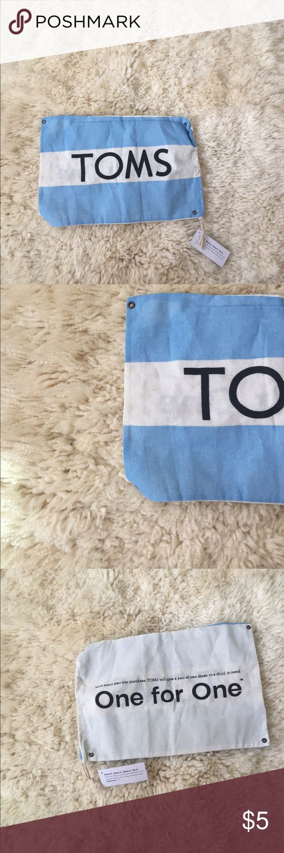 TOMS bag/logo flag! NWT TOMS bag/logo flag! Not sure what to call it but has a string to close the top! TOMS Bags Mini Bags