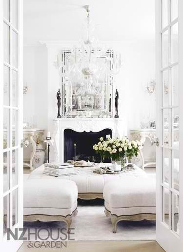 I would love to have a sitting room like this! white room, french doors, love the enormous ottomon