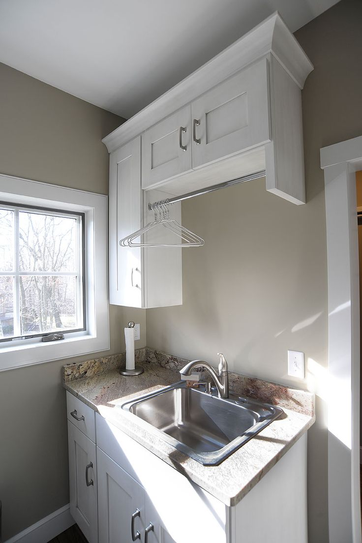 Laundry Room With Hanging Rod Above Sink For Drips Laundry Room Laundry Room Cabinets Wall