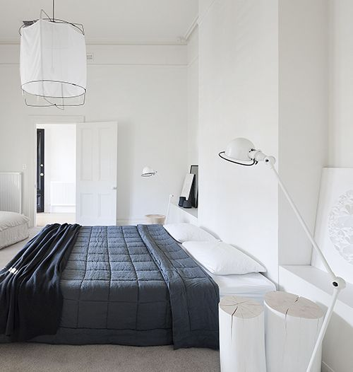 Bedroom in grey and white with a Signal S1833 floor lamp by Jieldé. Via Coco Lapine Design blog.