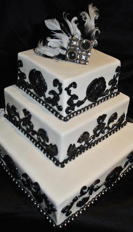Black and White Dramatic Wedding Cake #dramatic #blackandwhite #weddingcake #glamour #fascinator #love #wedding #sweetsisterchicsister