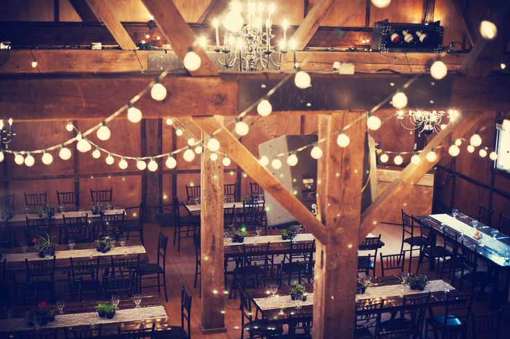 Gorgeous event lighting is a must, even when paired with rustic details! #MinnesotaWeddings Photo by Kim.