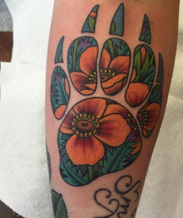 colorful bear paw tattoo with the floral pattern