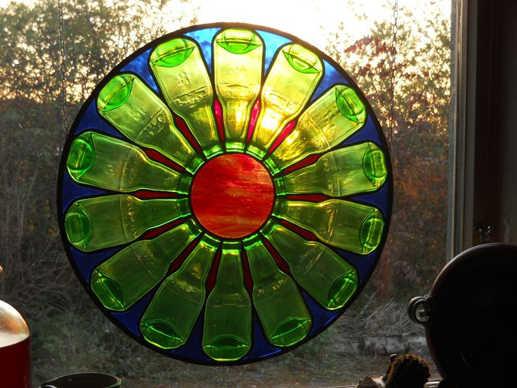 flattened wine or beer bottles in a kiln and put glass together for a window-wow