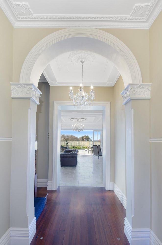 Entry hall using AS2 plaster strips with AK2 corner strips, AR60 ceiling centre, Custom Archway & AES2 corner staffs