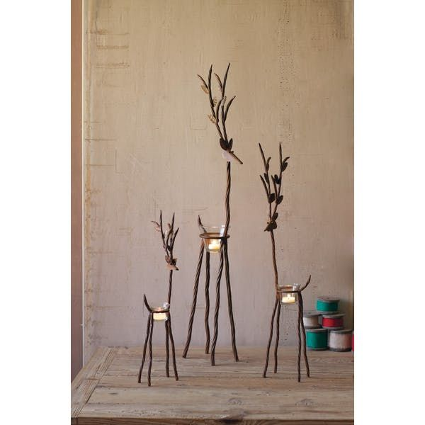 Kalalou Rustic Iron Reindeer With One Tealight. This Set of 3 beautiful Reindeer provide a unique, rustic way to display any small candles and light up any dinner table, or Christmas display. This trio looks great displayed together, or lighting up three separate areas!