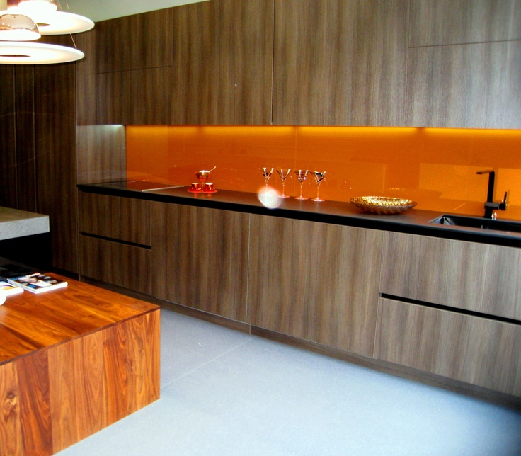 Funktional Kitchens have on display, a range from Barcelona. This example is of a wood effect door called Daku which works really well against this rich, burnt orange glass splashback, it looks quite retro and at the same time, modern with clean, straight lines.