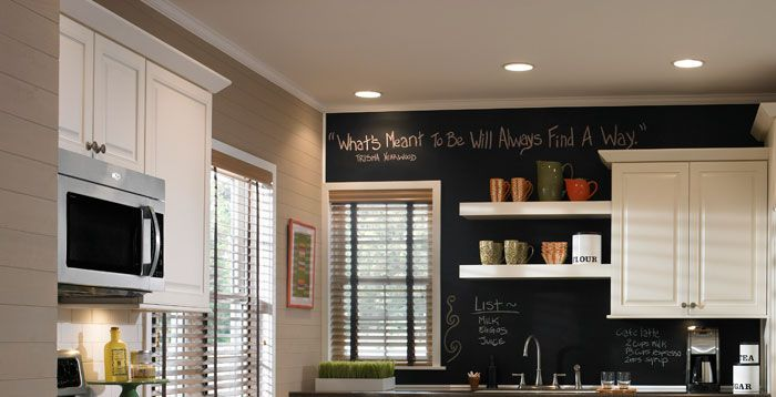 We love this modern kitchen complete with recessed lighting, open shelves, and a chalkboard wall!