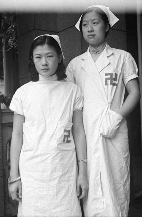 Two Red Swastika Society nurse in Shanghai, 1930. The Red Swastika Society is a Buddhist philanthropic society inspired by the Western Red Cross which works to feed and educate the poor. Although suppressed in mainland China since the Communist revolution, chapters of the organization still operate in Taiwan, Hong Kong, and Singapore