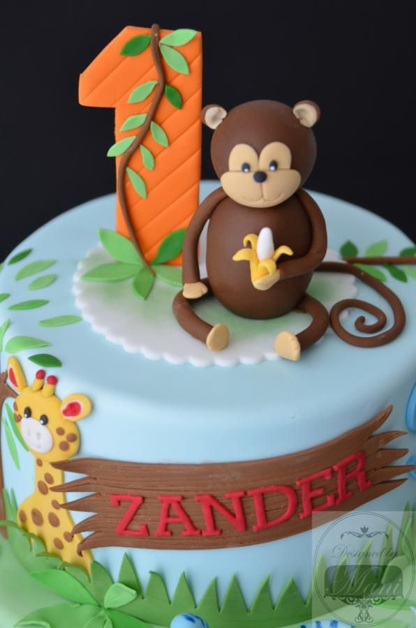 cute jungle themed first birthday cake made for Zander. all items on cake were hand crafted.