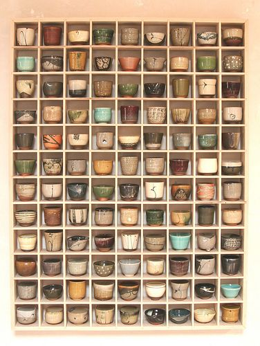 Betsy Williams. I love her work...a cup quilt...