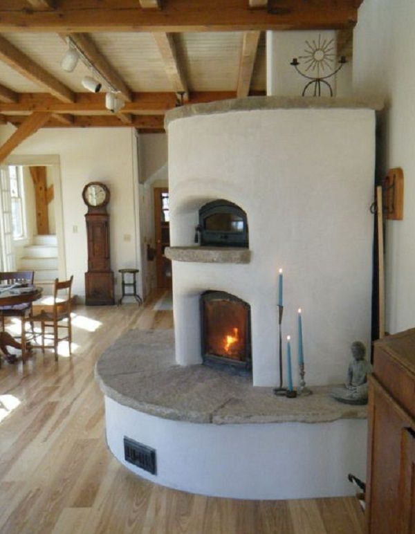 Masonry heater with oven. The curves smooth the transition into the room.
