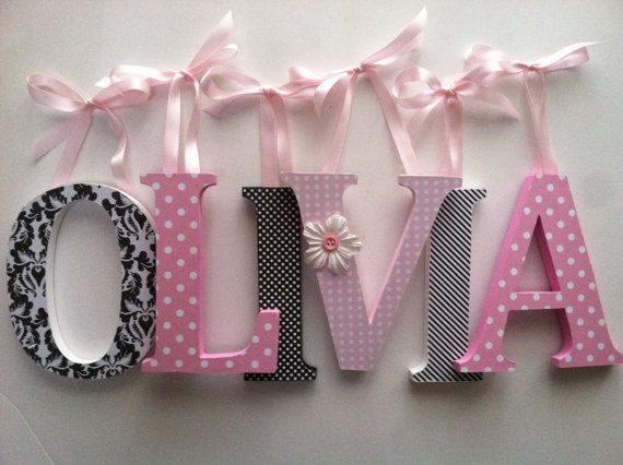 Wooden  letters for nursery in pink and black.