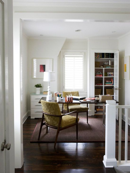 A small space off the stairs is just big enough for a home office. To increase storage, convert an unused closet into supply storage. Outfitted with cubbies, the closet is so organized that the door can be taken off and space passed off as a built-in bookcase.